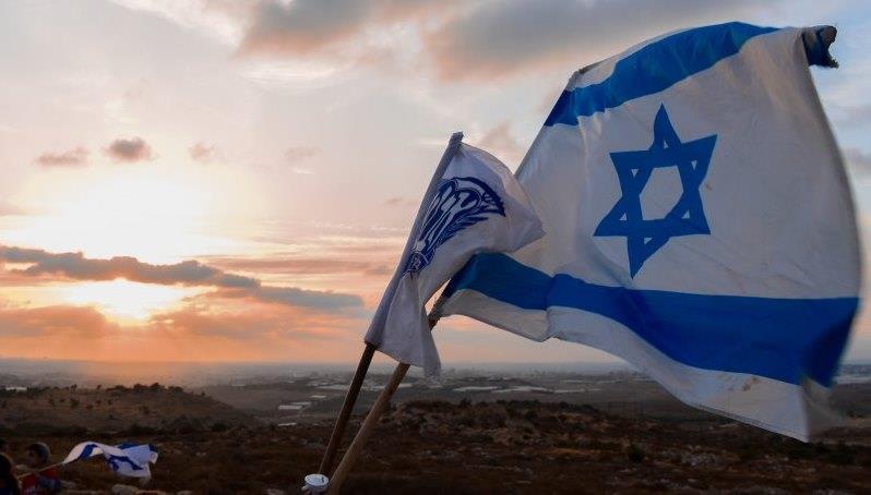 דגל ישראל ביישוב יהודי. אילוסטרציה Rina Gerashi-Levi/TPS