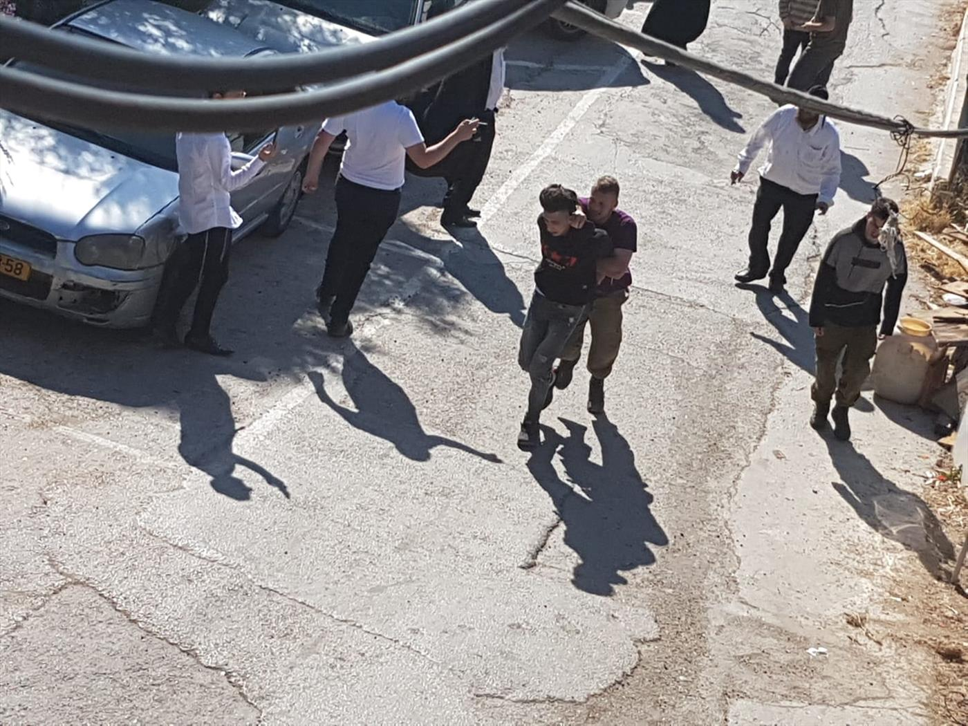 מעצרו של אחד מהתוקפים  (צילום:TPS)