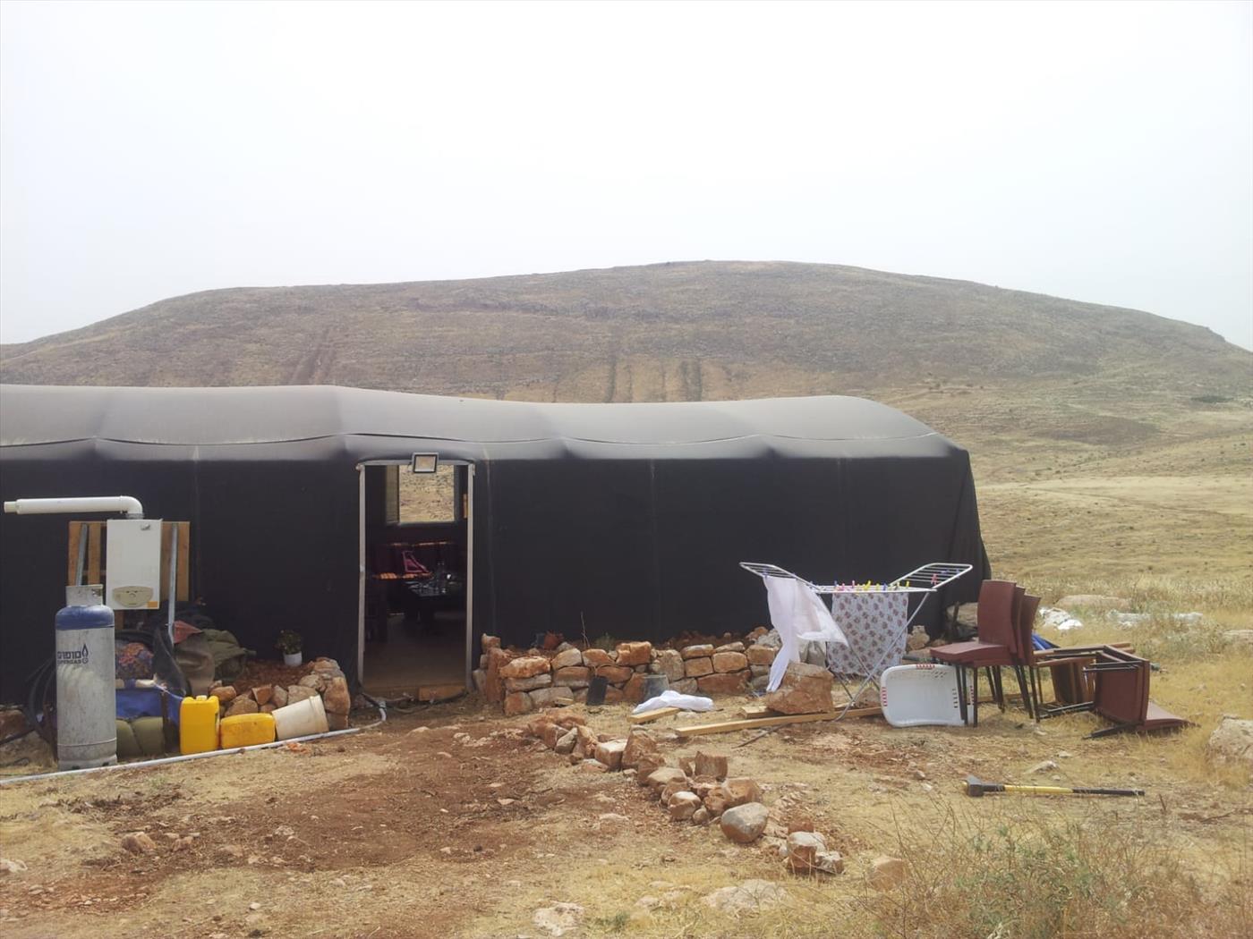 אחד מהמבנים הצפוי לההירס  (צילום: עמישב מלט)